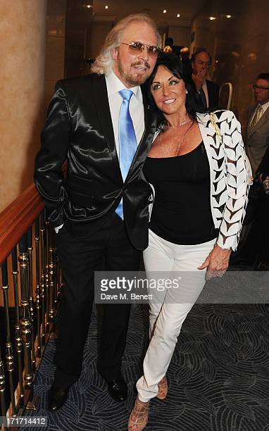 Barry Gibb and Linda Gibb attend the Nordoff Robbins O2 Silver Clef Awards at the London Hilton on June 28 2013 in London England