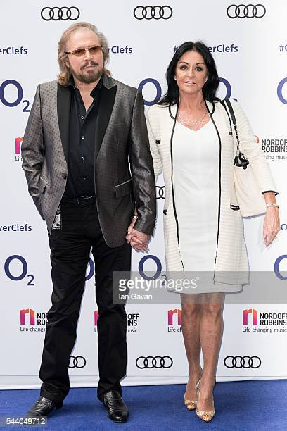 Barry Gibb and Linda Gibb attend the Nordoff Robbins O2 Silver Clef Awards at The Grosvenor House Hotel on July 1, 2016 in London, England.
