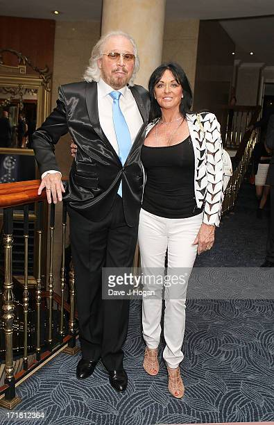 Barry Gibb and Linda Gibb attending the Nordoff Robbins Silver Clef Awards at London Hilton on June 28 2013 in London England