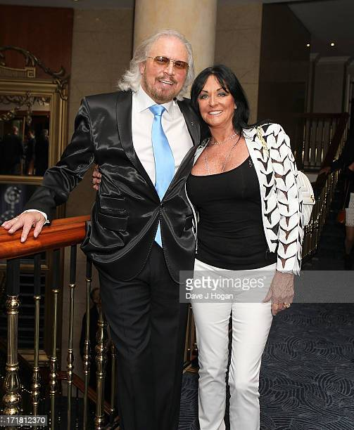 Barry Gibb and Linda Gibb attending the Nordoff Robbins Silver Clef Awards at London Hilton on June 28, 2013 in London, England.