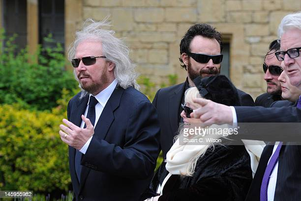 Barry Gibb and Robin's widow Dwina Murphy Gibb arrive for Robin Gibb's funeral at Priest End, Thame on June 8, 2012 in Oxford, England.