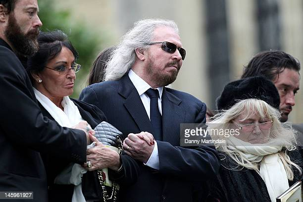 Barry Gibb and Robin's widow Dwina Murphy Gibb attend the funeral of Robin Gibb held at St. Mary's Church, Thame on June 8, 2012 in Oxford, England.