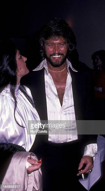 Barry Gibb and wife Linda Gibb attend the birthday party for Maurice Gibb on December 22 1982 at the Century Cafe in Century City California