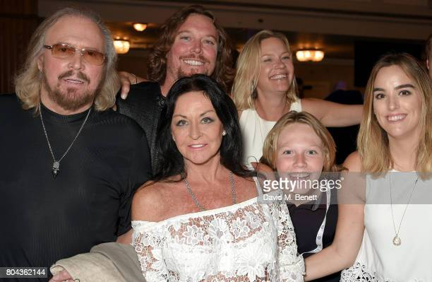 Barry Gibb, Ashley Gibb, Linda Gibb, Therese Gibb, Lucas Gibb and Alexandra Gibb attend the Nordoff Robbins O2 Silver Clef Awards at The Grosvenor...