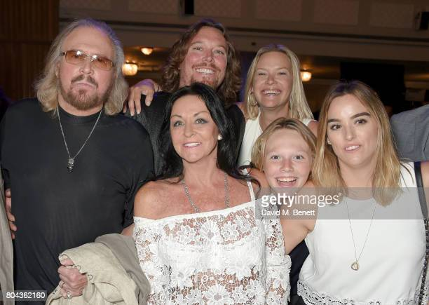 Barry Gibb Ashley Gibb Linda Gibb Therese Gibb Lucas Gibb and Alexandra Gibb attend the Nordoff Robbins O2 Silver Clef Awards at The Grosvenor House...