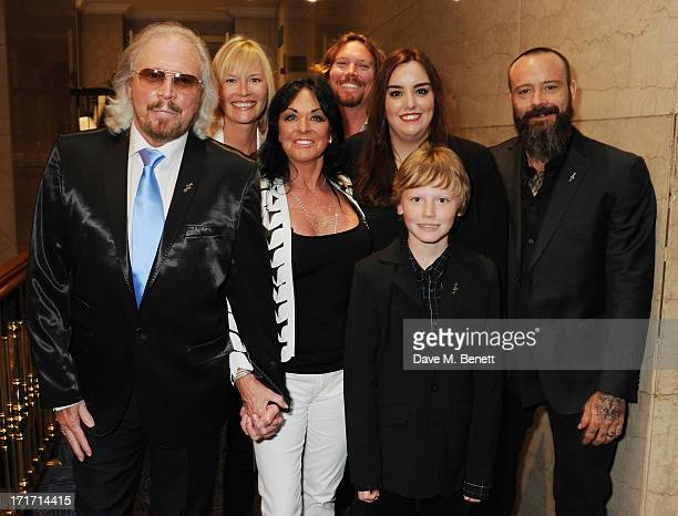 Barry Gibb, Linda Gibb and family attend the Nordoff Robbins O2 Silver Clef Awards at the London Hilton on June 28, 2013 in London, England.