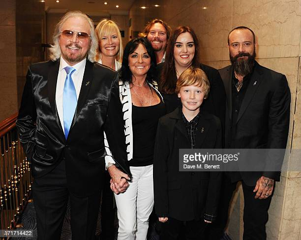 Barry Gibb Linda Gibb and family attend the Nordoff Robbins O2 Silver Clef Awards at the London Hilton on June 28 2013 in London England