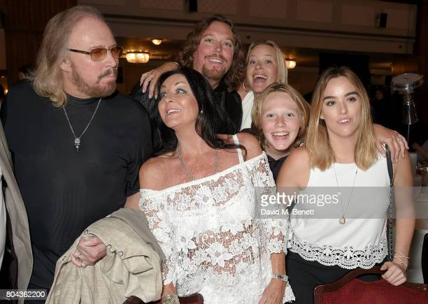 Barry Gibb Linda Gibb Ashley Gibb Therese Gibb Lucas Gibb and Alexandra Gibb attend the Nordoff Robbins O2 Silver Clef Awards at The Grosvenor House...