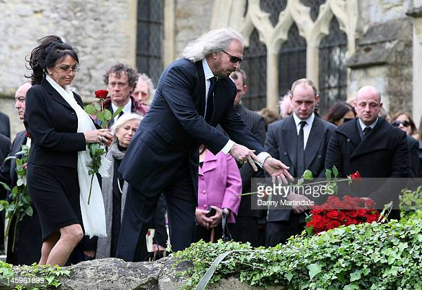 Barry Gibb places a rose on the coffin at the funeral of Robin Gibb held at St Mary's Church Thame on June 8 2012 in Oxford England