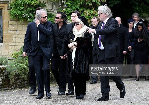 Barry Gibb Robin's son RobinJohn Gibb and Robin's widow Dwina Murphy Gibb and other members of the Gibb family arrive for Robin Gibb's funeral at...