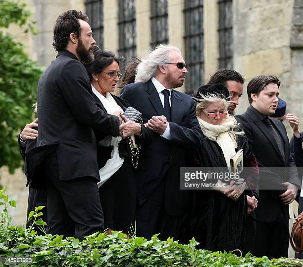 Barry Gibb , Robin's widow Dwina Murphy Gibb and Robin's son Robin-John Gibb attend the funeral of Robin Gibb held at St. Mary's Church, Thame on...