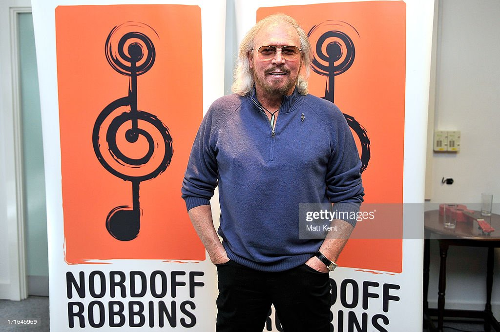 Barry Gibb visits the Nordoff Robbins Music Therapy Centre, prior to being awarded the 'Lifetime Achievement' award at the charity's annual luncheon (on June 28) to sit in on a therapy class on June 26, 2013 in London, England.