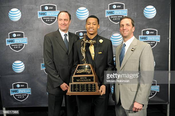 Barry Goheen Trey Burke and Eric Oberman pose with the 2013 Naismith Trophy at the NABC Guardians of the Game Awarding of the Naismith Trophy...