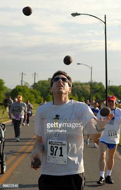 Barry Goldmeier of the Commodities Futures Trading Commission juggles during the 25th annual ACLI Capital Challenge 3 mile race in Anacostia Park