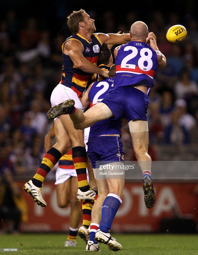 Barry Hall of the Bulldogs flies for a mark with Ben Rutten of the Crows during the round five AFL match between the Western Bulldogs and the Adelaide Crows at Etihad Stadium on April 23, 2010 in Melbourne, Australia.