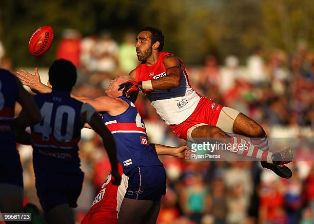 Barry Hall of the Bulldogs is spoiled by Adam Goodes of the Swans during the round eight AFL match between the Western Bulldogs and the Sydney Swans...