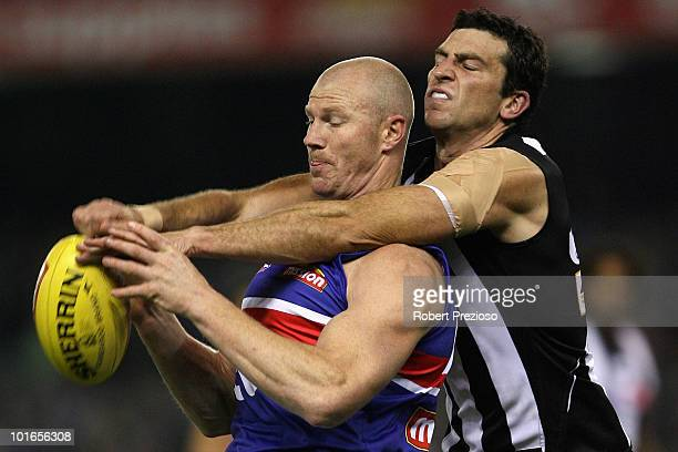 Barry Hall of the Bulldogs marks as Simon Prestigiacomo the Magpies attempts to spoil during the round 11 AFL match between the Collingwood Magpies...