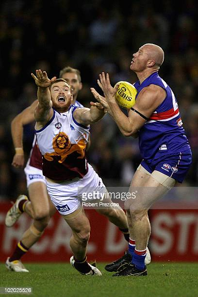 Barry Hall of the Bulldogs takes a mark during the round 12 AFL match between the Western Bulldogs and the Brisbane Lions at Etihad Stadium on June...