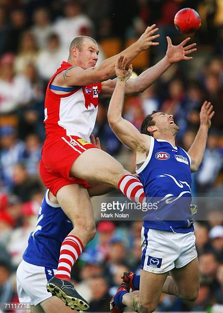 Barry Hall of the Swans takes a mark over Adam Simpson of the Kangaroos during the round ten AFL match between the Kangaroos and the Sydney Swans at...