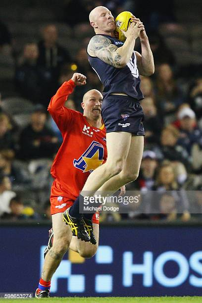 Barry Hall of Victoria marks the ball against Danny Southern of the All Stars during the EJ Whitten Legends match at Etihad Stadium on September 2...