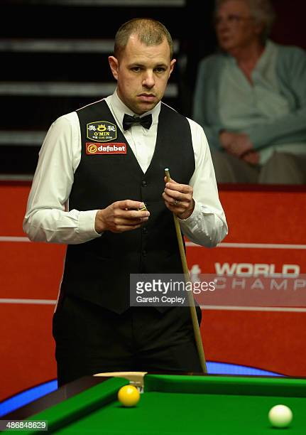 Barry Hawkins lines up a shot against Ricky Walden during their second round match in The Dafabet World Snooker Championship at Crucible Theatre on...