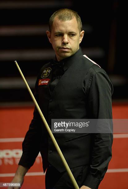 Barry Hawkins lines up a shot against Ronnie O'Sullivan during their semi final in The Dafabet World Snooker Championship at Crucible Theatre on May...