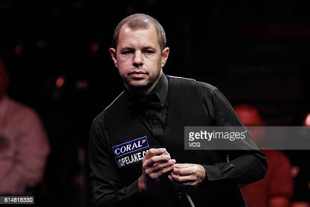 Barry Hawkins of England chalks the cue in the semifinals against Judd Trump of England on day six of the Coral English Open 2016 at Event City on...