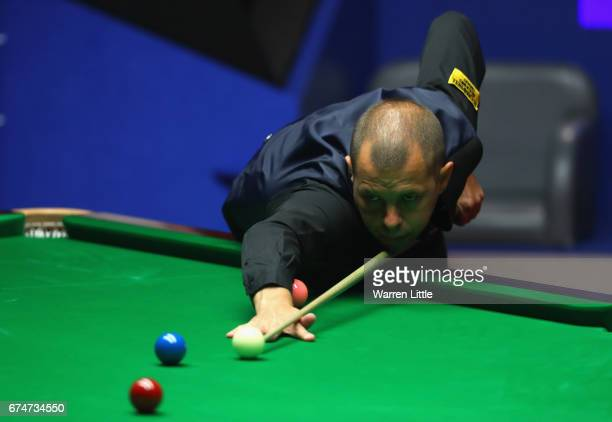 Barry Hawkins of England in action during the semifinal match against John Higgins of Scotland on day fifteen of Betfred World Championship 2017 at...