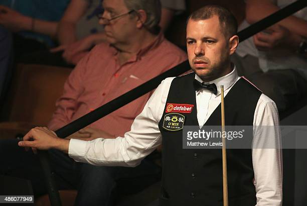 Barry Hawkins of England looks on during his match against David Gilbert of England during day four of the The Dafabet World Snooker Championship at...