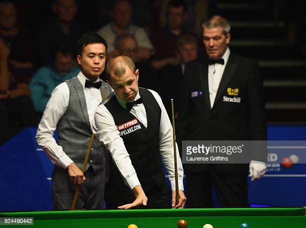 Barry Hawkins of England looks on during his quarter final match against Marco Fu from Hong Kong on day eleven of the World Championship Snooker at...