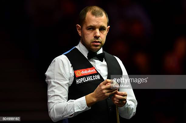 Barry Hawkins of England looks on during his quarter final match against Mark Allen of Northern Ireland during day five of The Dafabet Masters at...