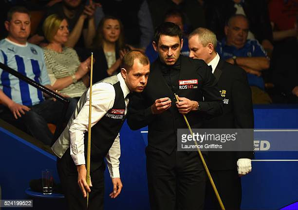 Barry Hawkins of England looks on during his second round match against Ronnie O'Sullivan of England on day ten of the World Snooker Championship at...