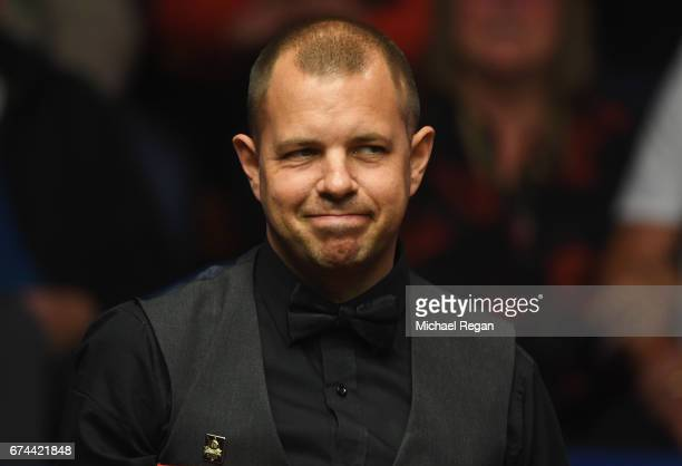 Barry Hawkins of England looks on during the semifinal match against John Higgins of Scotland on day fourteen of Betfred World Championship 2017 at...