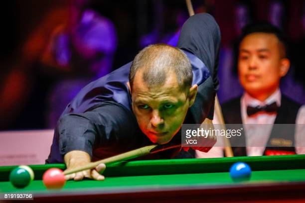 Barry Hawkins of England plays a shot during a quarterfinal match against Marco Fu of Chinese Hong Kong on day one of 2017 Hong Kong Masters at Queen...
