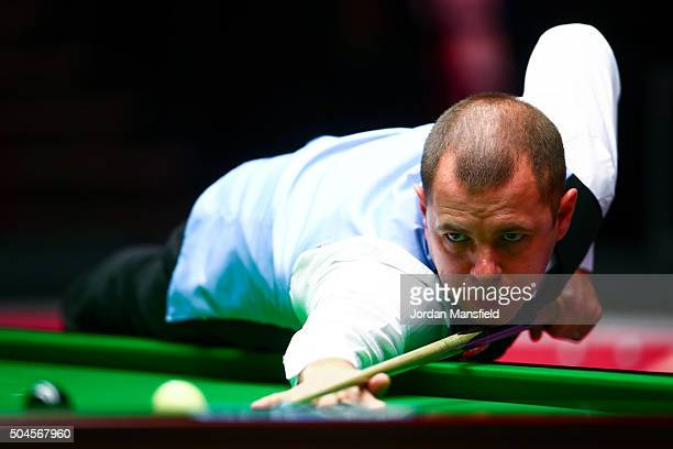 Barry Hawkins of England plays a shot during his first round match against Joe Perry of England during Day Two of the Dafabet Masters at Alexandra...