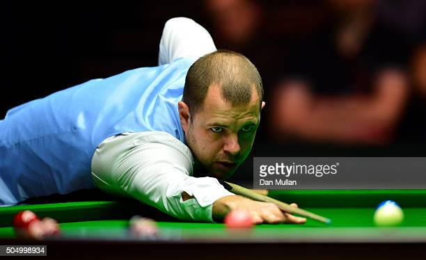 Barry Hawkins of England plays a shot during his quarter final match against Mark Allen of Northern Ireland during day five of The Dafabet Masters at...