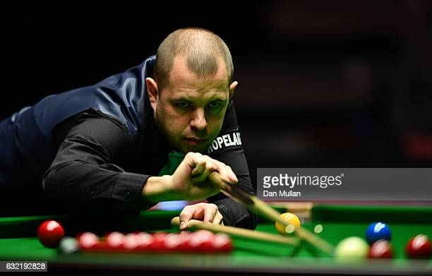 Barry Hawkins of England plays a shot during his quarter final match against Mark Selby of England on day six of the Dafabet Masters at Alexandra...