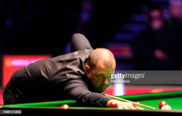 Barry Hawkins of England plays a shot during his quarterfinal match against Neil Robertson of Australia on day six of the 2019 Dafabet Masters at...