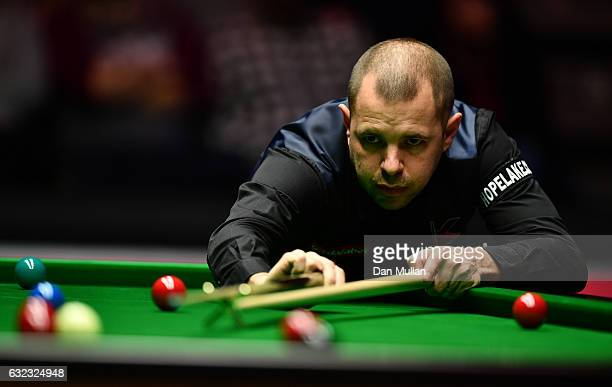 Barry Hawkins of England plays a shot during his semi final match against Joe Perry of England on day seven of the Dafabet Masters at Alexandra...