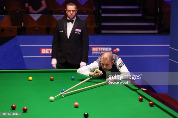 Barry Hawkins of England plays a shot during the Betfred World Snooker Championship Round Two match between Barry Hawkins of England and Kyren Wilson...