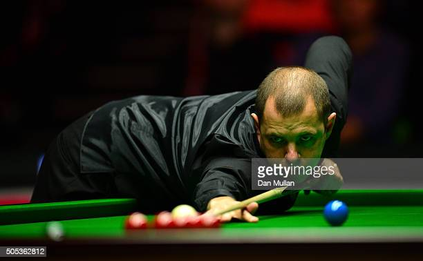 Barry Hawkins of England plays a shot during the Final match against Ronnie O'Sullivan of England during Day Eight of The Dafabet Masters at...