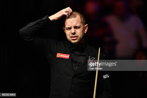 Barry Hawkins of England reacts during his semi final match against Joe Perry of England on day seven of the Dafabet Masters at Alexandra Palace on...