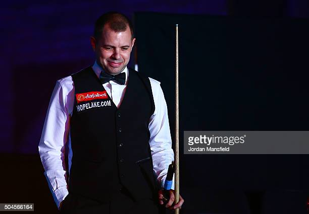 Barry Hawkins of England walks in ahead of his first round match against Joe Perry of England during Day Two of the Dafabet Masters at Alexandra...