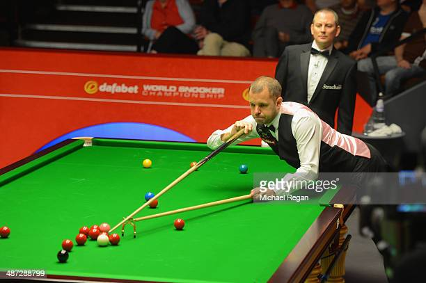 Barry Hawkins plays a shot against Dominic Dale in their quarter final match at the Crucible Theatre on April 29 2014 in Sheffield England