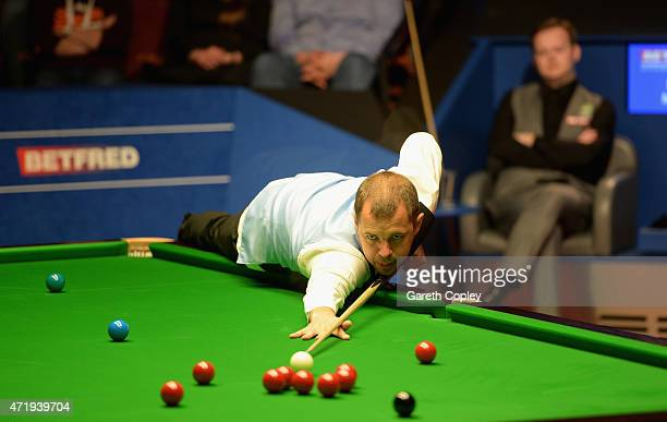 Barry Hawkins plays a shot against Shaun Murphy during their semi final on day fifteen of the 2015 Betfred World Snooker Championship at Crucible...