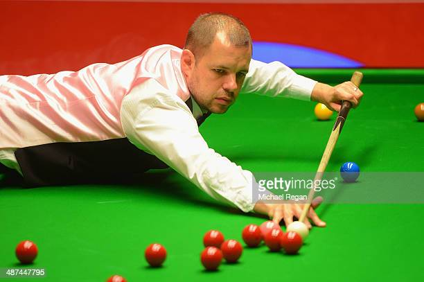 Barry Hawkins plays a shot in his quarter final match against Dominic Dale at the Crucible Theatre on April 30 2014 in Sheffield England