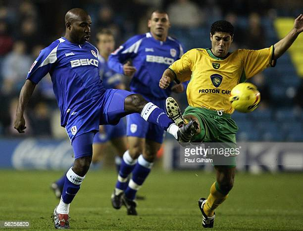 Barry Hayles of Millwall battles for the ball with Youssef Safri of Norwich City during the CocaCola Championship match between Millwall and Norwich...