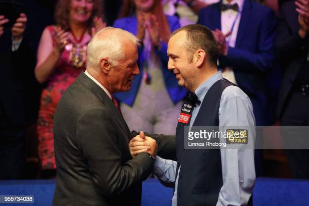 Barry Hearn, Chairman of World Snooker congratulates Mark Williams of Wales after he won the tournament during day seventeen of World Snooker...