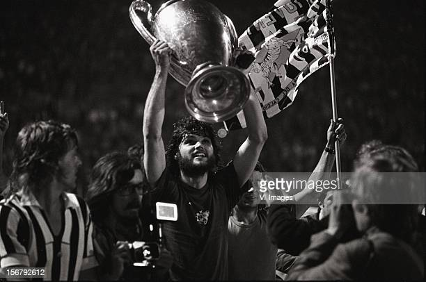 Barry Hulshof holds the cup after winning the European Cup final match between Ajax and Juventus at the Red Star Stadium on May 30 1973 in Belgrade...