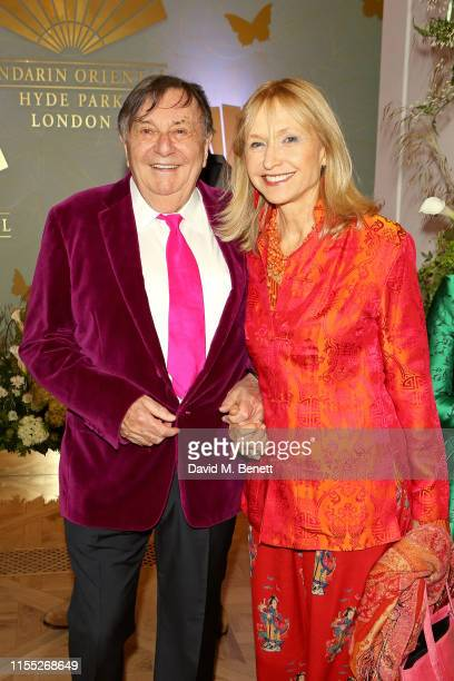 Barry Humphries and Lizzie Spender attend the Reinvented and Reimagined Mandarin Oriental Hyde Park London relaunch party on June 11 2019 in London...